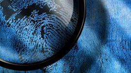 Magnifying glass with a big finger print