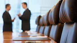 Men in boardroom arguing